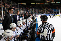 KELOWNA, CANADA - OCTOBER 5:  Referee Chris Crich stands at the bench of the Victoria Royals and speaks to head coach Dan Price against the Kelowna Rockets on October 5, 2018 at Prospera Place in Kelowna, British Columbia, Canada.  (Photo by Marissa Baecker/Shoot the Breeze)  *** Local Caption ***