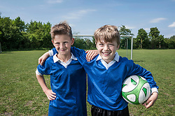 Friends boys young football players portrait
