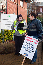 PCS members and supporters in Sheffield stage an eight-hour demonstration to protest  against the planned closure of the local office of the Driver and Vehicle Licensing Agency (DVLA). The protest was called to coincide with a visit to the premises by transport minister Mike Penning.on Monday (23 January) but according to Mike Mackie, assistant secretary of the PCS northern branch for the DVLA, the visit was canceled within 15 minutes of the Sheffield Demo being announced on the PCS website..Lauraine Compton PCS Rep for Lincoln with Sheffield Office Employee Rosly Jewitt.www.pauldaviddrabble.co.uk..23 January 2012 -  Image © Paul David Drabble