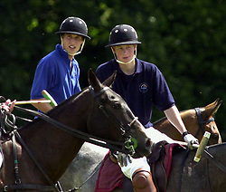 File photo dated 13/7/2002 of Prince Harry on the Eventers team and Prince William on the Jockeys team take a break whilst playing in the Jockeys v Eventers Charity polo match at Tidworth Polo Club, Wiltshire. Prince Harry has asked his brother the Duke of Cambridge to be his best man at his wedding to Meghan Markle, Kensington Palace said.