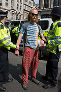 A protester is arrested by Met police officers at Oxford Circus on day 4 of protests by climate change environmental activists with pressure group Extinction Rebellion, on18th April 2019, in London, England.