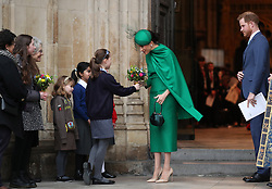 The Duchess of Sussex receives a posy as she leaves after the Commonwealth Service at Westminster Abbey, London on Commonwealth Day. The service is the Duke and Duchess of Sussex's final official engagement before they quit royal life.
