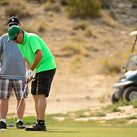 062913  Adron Gardner/Independent<br /> <br /> Lawrence Andrade puts on the green  at Fox Run Golf Course during the Bengal Cheer Golf Tournament in Gallup Saturday.