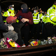 Hundreds of people gathered at a peaceful vigil for Sarah Everard on Clapham Common in South London on the 13th of March 2021, London, United Kingdom. Sarah Everard went missing on 3 March after setting off at 9pm from a friend's house to make her two-and-a-half-mile journey home and was days later found murdered. The police retreats out of the common. People had turned out to pay respect and love and mourn Sarah Everard as well as all the women and girls who on a daily basis are hurt by men. It was an event full of sadness and reflection and anger but peaceful. The vigil was not sanctioned by police because of Covid restrictions and the police decided to arrest a number of people in an attempt to break up the peaceful and highly emotional vigil. The event took place around the band stand on the common and speeches were held from the stand till police confiscated the sound equipment. The police have since been highly criticized for their handling of the event.