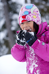 North America, United States, Washington, Crystal Mountain, girl eating snow MR