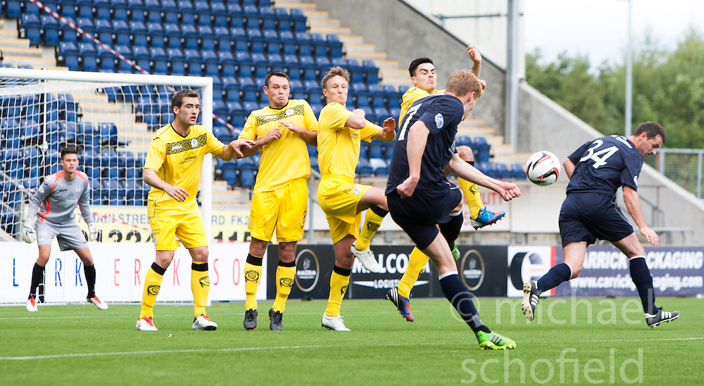 Falkirk's Jay Fulton hits the Queen of the South's wall for a penalty.<br /> Falkirk 2 v 1 Queen of the South, Scottish Championship 5/10/2013, played at The Falkirk Stadium.<br /> ©Michael Schofield.