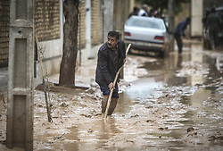 March 26, 2019 - Shiraz, Iran - A man clears away mud after a flood caused by heavy rains in southern Iran. At least 25 people were killed in the heavy rains and subsequent floods in Iran over the past week. (Credit Image: © Ahmad Halabisaz/Xinhua via ZUMA Wire)