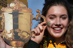 © Licensed to London News Pictures. 31/10/2015. London, UK. An Australian rugby fan poses for a trophy photo as she arrives for the Rugby World Cup final at Twickenham. Photo credit: Peter Macdiarmid/LNP
