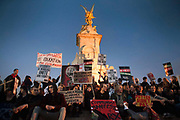 Students who have broken away from the official rally sit outside Buckingham Palace, many calling for a revolution. Thousands of students turned out to a march against fees and cuts in the education sector, calling for workers and students to unite against the Government's austerity policies.