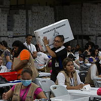 During a partial recount of votes in the Supreme Electoral Tribunal, TSE, workers counting are overseen by international observers. Many irregularities in the electoral process have been identified by the EU and EOA observer teams. A full recount has been requested. The elections were held on Nov 26 and there was no final declaration of results by Dec 13th.