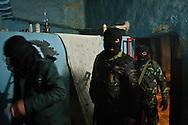 Members of the Free Syrian Army patrol and guard against sniper attacks at night, Al Janoudiyah,, Syria