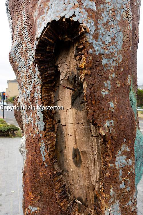 Kirkcaldy, Scotland, UK. 1 Sept, 2018. Wooden sculpture named Phantom by renowned Scottish artist David Mach has been cordoned off from the public following reports that debris is falling from the work. The wooden sculpture is made from a piece of driftwood with tens of thousands of nails driven into it and was commissioned by Morrisons supermarket for £35,000. Damage to the work is obvious but whether the fallen small pieces of wood and nails pose a risk to the public is open to debate.