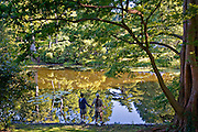 AJ (age 12) and LB (age 10) marvel at the mirror-like reflection of the woods surrounding Auburn Lake in Belmont, Massachusetts.