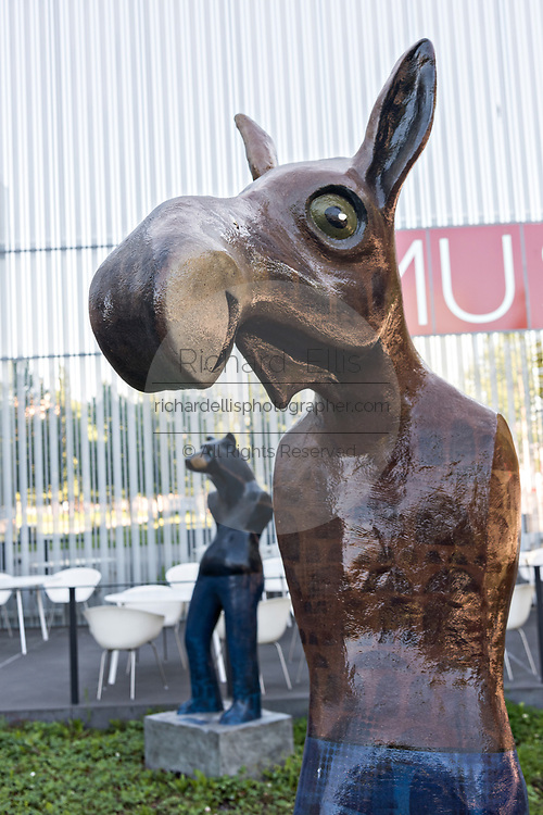 Whimsical statues of moose and bears as people by sculptor Rachelle Dowdy in the sculpture garden at the Anchorage Museum in downtown Anchorage, Alaska.