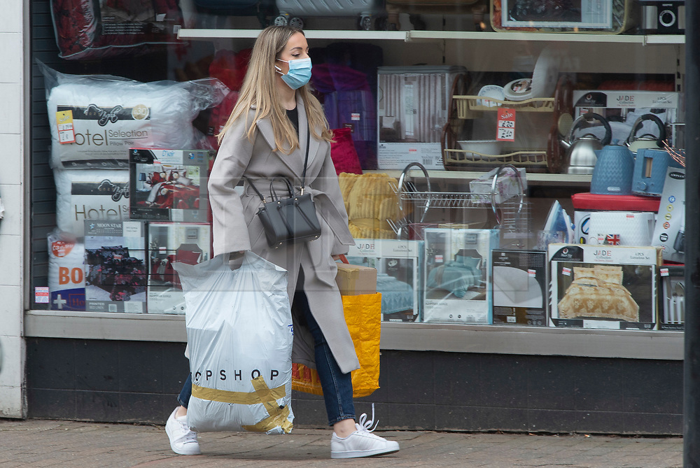 © Licensed to London News Pictures 03/03/2021. <br /> Bromley, UK. A woman out shopping. People out and about in Bromley High Street in South East London today during a third national coronavirus lockdown. Non-essential shops could open in weeks if the Covid-19 infection rate keeps dropping. Photo credit:Grant Falvey/LNP