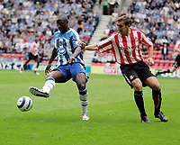 Photo: Peter Phillips.<br /> Wigan Athletic v Sunderland. The Barclays Premiership.<br /> 27/08/2005.<br /> Jason Roberts neatly flicks the ball away from Alan Stubbs
