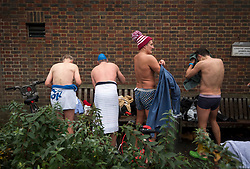 © Licensed to London News Pictures. 25/12/2017. London, UK. Competitors getting dresses after the race. Members of the Serpentine Swimming Club brave the cold waters at the Serpentine Lake in Hyde Park, London to compete for the traditional Peter Pan Cup on Christmas Day, December 25, 2017. Photo credit: Ben Cawthra/LNP