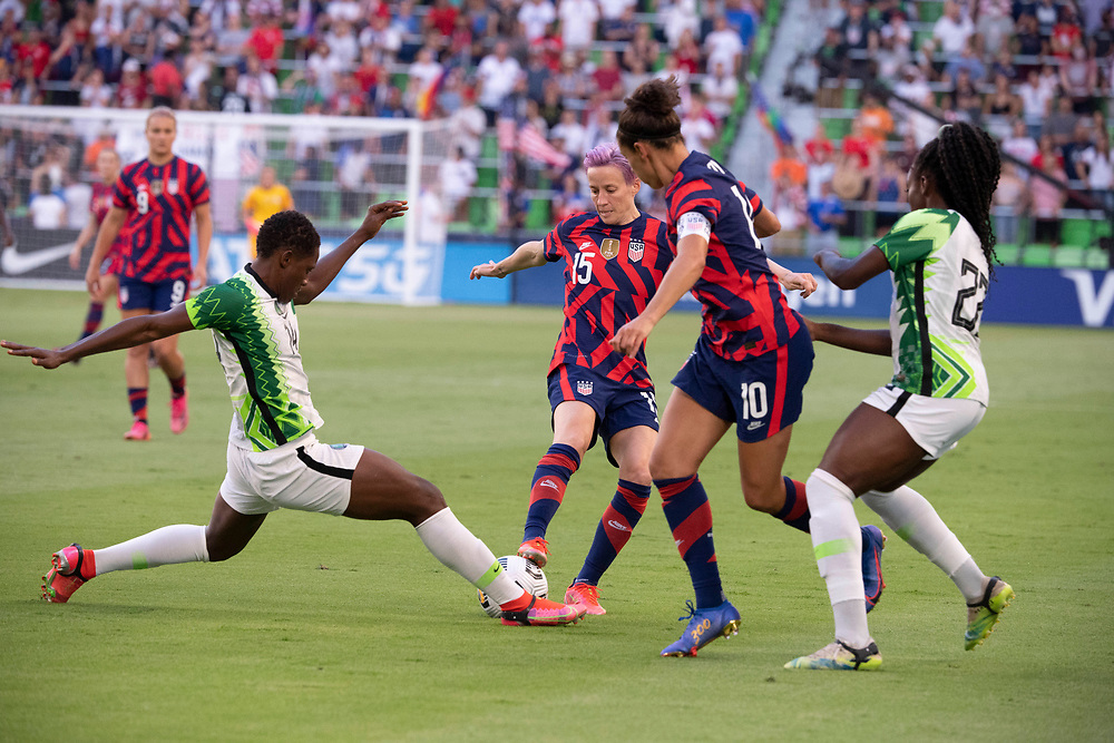 USA's MEGAN RAPINOE (15) and CARLI LLOYD (10) try to evade two Nigerian defenders in the first half of the US Women's National Team (USWNT) 2-0 victory over Nigeria, in the first match at Austin's Q2 Stadium. The U.S. women's team, an Olympic favorite, is wrapping up a series of summer matches to prep for the Tokyo Games. Press scored a goal in the win for USA Soccer. Defending are CHIDINMA OKEKE (14) and MICHELLE ALOZIE (22) of Nigeria.