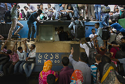 June 14, 2018 - June 14, 2018, Dhaka, Bangladesh – Bangladeshis people travel by train as they going their home to be with their families ahead of the Muslim festival of Eid al-Fitr, in Dhaka. Eid al-Fitr, the biggest Muslim festival celebrates the end of the holy fasting month of Ramadan. (Credit Image: © K M Asad via ZUMA Wire)