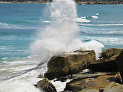 """Indian Ocean (or Southern Ocean according to Australian geographers) waves crash onto granite shoreline at Wilson's Promontory National Park in the Gippsland region of Victoria, Australia. Drive two hours from Melbourne to reach Wilson's Promontory, or """"the Prom,"""" which offers natural estuaries, cool fern gullies, magnificent and secluded coastal beaches, striking rock formations, and abundant wildlife."""