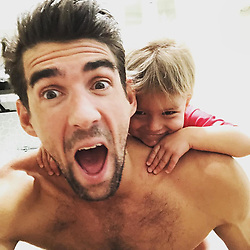 "Michael Phelps releases a photo on Instagram with the following caption: ""@boomerrphelps is climbing on me like he\u2019s a \ud83d\udc12. Ahhhhh WATCH OUT!!!"". Photo Credit: Instagram *** No USA Distribution *** For Editorial Use Only *** Not to be Published in Books or Photo Books ***  Please note: Fees charged by the agency are for the agency's services only, and do not, nor are they intended to, convey to the user any ownership of Copyright or License in the material. The agency does not claim any ownership including but not limited to Copyright or License in the attached material. By publishing this material you expressly agree to indemnify and to hold the agency and its directors, shareholders and employees harmless from any loss, claims, damages, demands, expenses (including legal fees), or any causes of action or allegation against the agency arising out of or connected in any way with publication of the material."