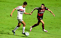 SAO PAULO, BRAZIL - FEBRUARY 25: Filipe Luis of CR Flamengo competes for the ball with Igor Gomes of Sao Paulo FC ,during the Brasileirao Serie A 2020 match between Sao Paulo FC and CR Flamengo at Morumbi Stadium on February 25, 2021 in Sao Paulo, Brazil. (Photo by MB Media/BPA)