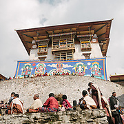 Rolling and packing of the Thongdrel. A Thongdrel is a large appliqué religious image normally only unveiled during tsechus, the main religious festivals in Bhutan. They are the largest form of thangka paintings in the tradition of Tibetan Buddhism. The Tshechu of the Gasa monastery on the road leading to Laya. Tshechu are annual religious Bhutanese festivals held in each district on the tenth day of a month of the lunar Tibetan calendar. Tshechus are large social gatherings, which perform the function of social bonding among people of remote and spread-out villages.