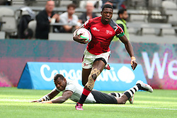 March 9, 2019 - Vancouver, BC, U.S. - VANCOUVER, BC - MARCH 09:  Vincent Onyala (4) of Kenya avoids the tackle by Asaeli Tuivuaka (8) of Fiji to run the ball in for a try during day 1 of the 2019 Canada Sevens Rugby Tournament on March 9, 2019 at BC Place in Vancouver, British Columbia, Canada. (Photo by Devin Manky/Icon Sportswire) (Credit Image: © Devin Manky/Icon SMI via ZUMA Press)