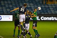 Football - 2020 / 2021 Sky Bet (EFL) Championship - Millwall vs Birmingham City  - The Den<br /> <br /> Matt Smith (Millwall FC) heads clear as players wait to pounce<br /> <br /> COLORSPORT/DANIEL BEARHAM