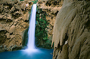 """The Havasupai tribe call it """"Mother of the Waters,"""" and others call this 200-foot waterfall Mooney Falls (after a miner who fell to his death here), on Havasu Creek, in the Havasupai Indian Reservation, Arizona, USA."""