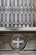 Detail of wrought iron, stone carving and graffiti, Zadar, Croatia