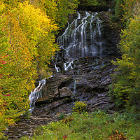 I traveled up way north to New Hampshire to Colebrook and North Country to look for the beginning of fall foliage and moose. No luck with moose but I found some early vibrant autumn colors at Beaver Brook Falls. This waterfall is right off the street with easy access and makes for a great nature experience. Loved photographing this waterfall because it was somewhat remote and the early morning sun beautifully painted the trees and canopies framing the falls.     <br />