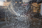 Smashed glass window on 7th October 2020 in Birmingham, United Kingdom. Tempered or toughened glass is a type of safety glass processed by controlled thermal or chemical treatments to increase its strength compared with normal glass.