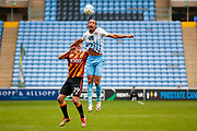 Bradford City defender Anthony McMahon (29) challenges Coventry City forward Kwame Thomas (14) for the ball  during the EFL Sky Bet League 1 match between Coventry City and Bradford City at the Ricoh Arena, Coventry, England on 11 March 2017. Photo by Simon Davies.