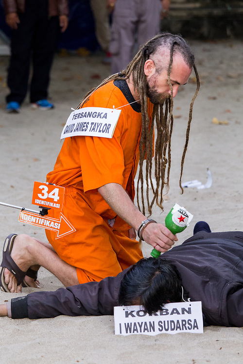 David Taylor, one of the prime suspects to the murder of police officer Wayan Sudarsa, is seen at the crime scene taking part in the murder re-enactment on August 31, 2016, in Kuta.  Bali, Indonesia.<br /> <br /> Australian Sara Connor and British David Taylor are accused of murdering a Bali police officer, Wayan Sudarsa, after his body was found with 42 wounds, including to his head and neck, at Kuta beach on 17 August. According to reports, investigators said six new witnesses came forward in the case against Connor and her boyfriend Taylor, as both suspects returned to the scene of the crime on Wednesday for a full reconstruction of the officer's death.
