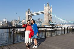 © Licensed to London News Pictures. 08/05/2018. London, UK. Tourists take a selfie in front of Tower Bridge in the sunshine and warm weather on the South Bank in London this morning. Photo credit: Vickie Flores/LNP
