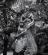 William Rickets Sanctuary - Black and white photo art print of Sculpture of an Aboriginal man and boy in the deep woodland of the Dandenon Mountain near Melbourne Australia. Taken 1993 by Paul Williams,