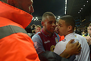 Leandro Bacuna of Aston Villa being escorted off the field by Stewards during pitch invasion after the game. The FA cup, 6th round match, Aston Villa v West Bromwich Albion at Villa Park in Birmingham, Midlands on Saturday 7th March 2015<br /> pic by John Patrick Fletcher, Andrew Orchard sports photography.
