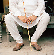 Portrait of nawab holding cane, Lucknow, Uttar Pradesh, India. The term Nawab is often used to refer to any Muslim ruler or leader in the North of India.