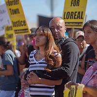 Edward Jaramillo and Camille Gishie, friends of Loreal Tsingine, hold each other at the Justice for Loreal vigil in front of the Winslow Police Department Saturday.