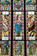 Contemporary stained glass windows by V Stanek and J Sebek featuring cherubs in a garden on the upper floor of the Lucerna Cinema, on 19th March, 2018, in Prague, the Czech Republic. The most elegant of Nove Mesto's many shopping arcades runs through the art-nouveau Lucerna Palace 1920, between Stepanska and Vodickova streets. The complex was designed by Vaclav Havel grandfather of the former president, and is still partially owned by the family. It includes theatres, a cinema, shops, a rock club and several cafes and restaurants.