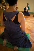 Buddhists meditate in silence for 30 minutes in their Shrine Room at the Rivendell Buddhist Retreat Centre, England.