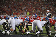 Mississippi Rebels offensive lineman Robert Conyers (75) snaps to Mississippi Rebels quarterback Chad Kelly (10) at Vaught-Hemingway Stadium at Ole Miss in Oxford, Miss. on Saturday, September 26, 2015. (AP Photo/Oxford Eagle, Bruce Newman)
