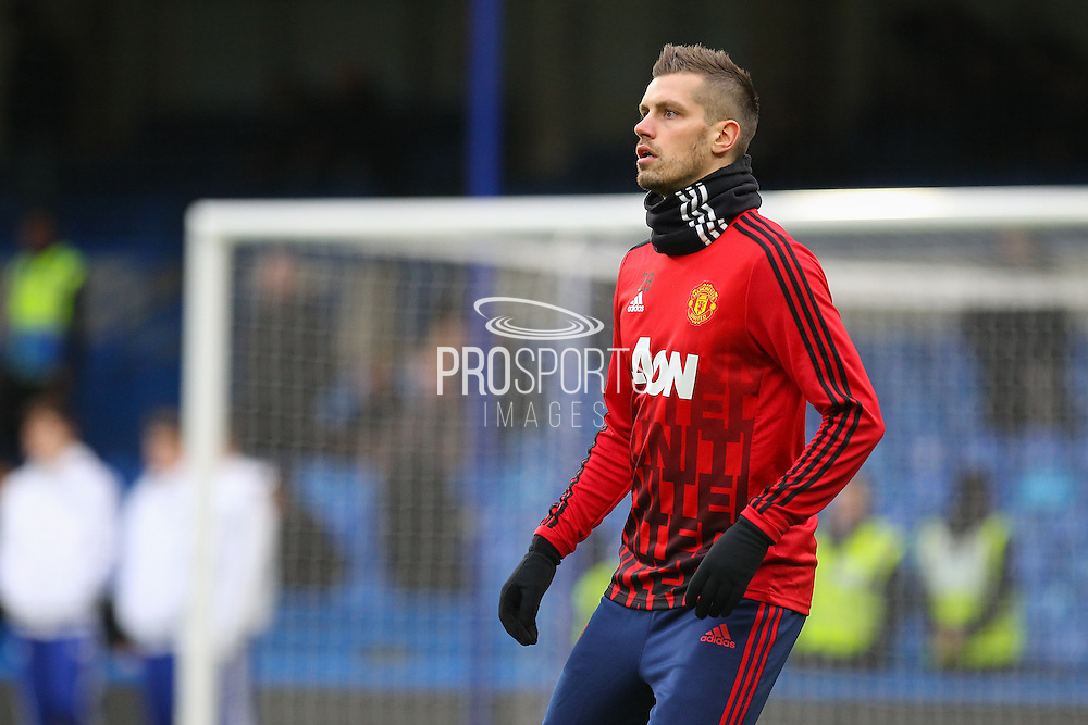 Morgan Schneiderlin of Manchester United in the warm up during the Barclays Premier League match between Chelsea and Manchester United at Stamford Bridge, London, England on 7 February 2016. Photo by Phil Duncan.