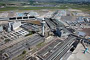 Nederland, Noord-Holland, Haarlemmermeer, 12-05-2009; luchthaven Schiphol met stationsgebouw en verkeertoren met vluchtleiding..Linksonder  parkeergarages en parkeerdekken, daar achter hotels en diverse kantoorgebouwen geexploiteerd door Schiphol vastgoed (Schiphol Real Estate). Aan de gates geparkeerde vliegtuigen van onder andere KLM en MartinAir. In de achtergrond de A4 en het parkeerterrein voor langparkeren..Swart collectie, luchtfoto (toeslag); Swart Collection, aerial photo (additional fee required).foto Siebe Swart / photo Siebe Swart