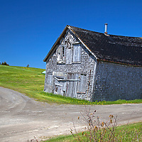 North America, Canada, Nova Scotia. Aged barn reflects charcter of the landscape and scenery of Nova Scotia.