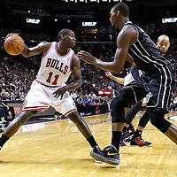 29 January 2012: Miami Heat power forward Chris Bosh (1) defends on Chicago Bulls shooting guard Ronnie Brewer (11) during the Miami Heat 97-93 victory over the Chicago Bulls at the AmericanAirlines Arena, Miami, Florida, USA.