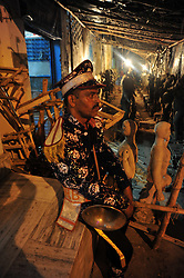 September 26, 2016 - Allahabad, Uttar Pradesh, India - Allahabad: A band Artist rest before perform during a religious procession Ravan ki Barat in Allahabad on September 26, 2016, held to mark the Dussehra festival. The name Dussehra is derived from Sanskrit Dasha-hara literally means removal of ten referring to Lord Rama's victory over the ten-headed demon king Ravana. Dussehra is celebrated on the tenth day of the month of Ashwin according to the Hindu calendar which corresponds to September or October of the Gregorian calendar. (Credit Image: © Prabhat Kumar Verma via ZUMA Wire)