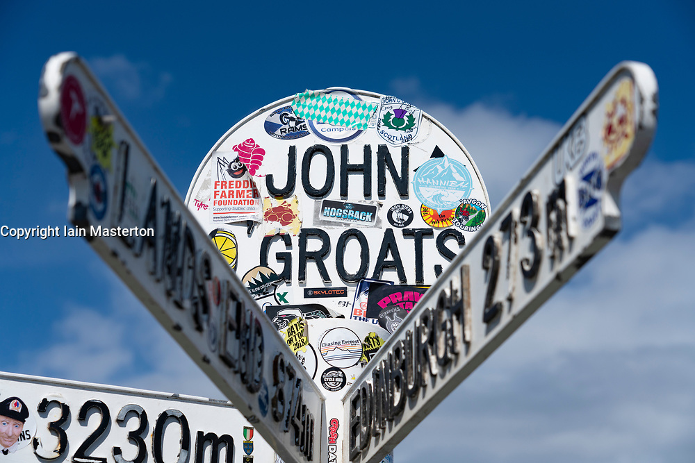 Distance marker direction signs at John O' groats on the North Coast 500 tourist motoring route in northern Scotland, UK