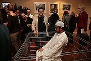 Douglas Fishbone ( white jacket) with his piece' Untitled' , Paranoia. Curated by Predrag Pajdic. The Freud Museum.  London. 11 January 2007. -DO NOT ARCHIVE-© Copyright Photograph by Dafydd Jones. 248 Clapham Rd. London SW9 0PZ. Tel 0207 820 0771. www.dafjones.com.